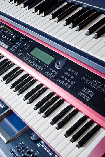 music keyboards on a rack