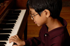 piano player playing a piano