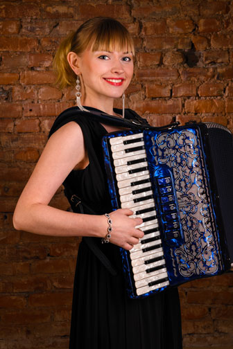 young woman playing an accordion